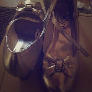 I'm selling some silver heels